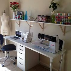Custom built desk to hold sewing machine, computer, silhouette, and laptop.