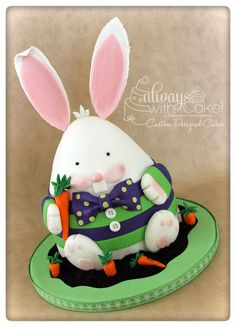 Meet Fred.  He was inspired by Lesely @ the Royal Bakery.  Just before I made him, I had seen a guy in a green and purple shirt and decided those would be the colors for my chubby bunny.  I added the bow tie to give him a bit more pazazz.  :-)  TFL