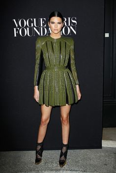 Turning heads at the Balmain Fashion Show After-Party, Kendall wears a structured olive leather dress.