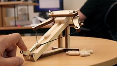 A build-your-own desktop ballista kit, complete with mini wooden bullets.