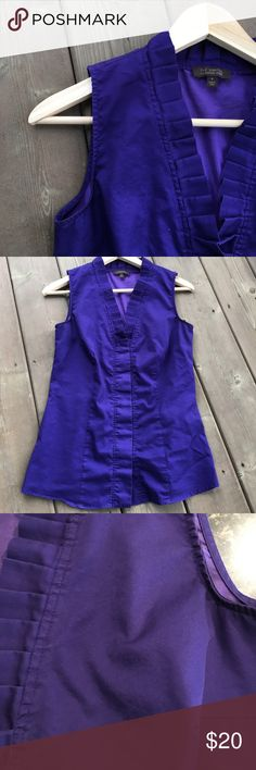 The Limited button down tank top The Limited button down tank top.  This tank is a true purple color- think princes classic purple suit 😉.  The color is closest to the third picture.  Size small with a pleated neckline that leads to the first button.  Made of 60% cotton and 40% polyester.  No holes, tears, or stains.  Offers considered through offer button. The Limited Tops Button Down Shirts