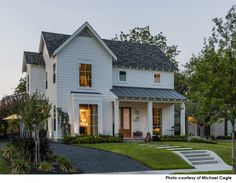 the home's exterior, recalling traditional farmhouse and four-square archetypes, gives way to a modern interior consisting of clean lines. Each room in the home spotlights the owners' heritage, their love of travel and their fondness for Midcentury Modern furniture and style. Likewise, each piece in the home tells a story, from the