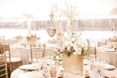 Handmade Wedding Centerpiece  Photography: Jana Williams Photography Read More: http://www.insideweddings.com/weddings/ivory-gold-blush-lakefront-new-hampshire-wedding/412/