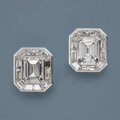 Two substantially sized emerald-cut diamonds, weighing and carats respectively, dazzle in these gorgeous platinum and baguette diamond earrings. The emerald-cut diamonds are framed with over carats of precision-cut cali Emerald Cut Diamond Earrings, Emerald Cut Diamonds, Diamond Studs, Diamond Jewelry, Diamond Ice, Pink Diamonds, Antique Jewelry, Vintage Jewelry, Bijou Box