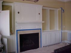 Builer white fireplace surround - BEFORE Fireplace Makeover