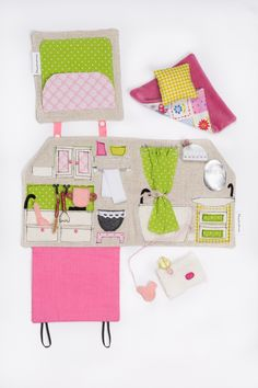 You only need a small flat surface to start playing with this miniature, portable, sewn dollhouse with several pockets and secrets.