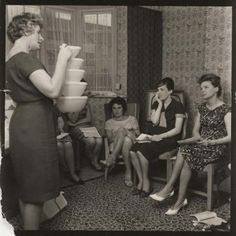 Socialise more in real life instead of Facebook (Woman demonstrating products at a Tupperware party, 1963, Unknown, National Media Museum)