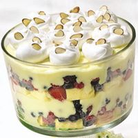 Banana pudding layered with berries.  Delicious.