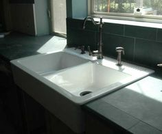 Sink from IKEA, drilled for soap dispenser and spray attachment, if needed.