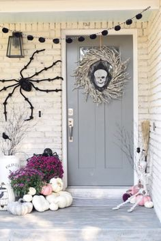A non-traditional approach to Fall and Halloween decor. Use black and white and a pop of pink for an updated, chic look on your porch! HomeGoods Sponsored Pin....