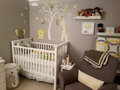 Premium Self Adhesive Fabric Nursery Wall Decals Jungle Wall Decals featuring a giraffe, lion and elephant around a white tree mural in yellow grey