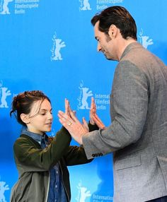 "Hugh Jackman Photos Photos - British-Spanish actress Dafne Keen (L) and Australian actor Hugh Jackman pose for photographers during a photocall for the film ""Logan"" in competition at the 67th Berlinale film festival in Berlin on February 17, 2017. / AFP / Tobias SCHWARZ - 'Logan' Photo Call - 67th Berlinale International Film Festival"