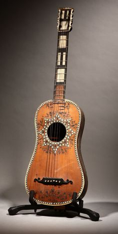 Lot# 1094 A Continental Baroque bone-inlaid ebonized guitar. est: $1000/2000 *Price Realized: $10,200.00
