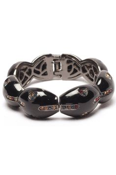 Black Color Designer Bracelet    This bracelet stands out with its fascinating design and skillfully placed stones. Be it a kitty party with the club ladies or a formal meeting with the board members, you can blindly bank on this piece. A must have for those who prefer hassle free lifestyle.