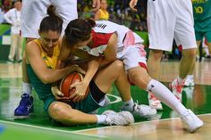 Japan's small forward Mika Kurihara (R) seizes the ball from Australia's shooting guard Katie Rae Ebzery during a Women's round Group A basketball match between Japan and Australia at the Youth Arena in Rio de Janeiro on August 11, 2016 during the Rio 2016 Olympic Games. / AFP / Andrej ISAKOVIC
