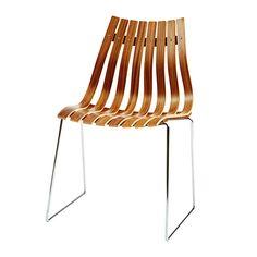 Scandia Junior chair. Designer:HansBrattrud 1957 Design: Hans Brattrud, 1957  Norsk klassiker relansert av Fjord Fiesta. Materialer: Amerikansk valnøtt, lys eik. Bein i matt stål. Høyde: 82 cm Sittehøyde: 42 cm Bredde: 54 cm Dybde: 51 cm
