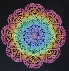 Rainbow doily, hand crocheted by Raine59, made from hand-dyed thread.