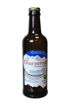 Biere Tourmente Blanche 33cl  Bière blanche, brassée à Briançon dans les hautes-alpes par la brasserie artisanale des grands cols.  Pour l'apprécier pleinement, conservez-la au frais et dégustez-la entre 6 et 8°  Ingrédients : eau, malt d'orge et de froment, houblon, arômes et épices.  Degrés d'alcool : 5,1°