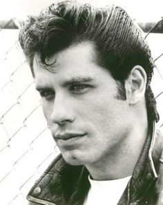 """John Travolta sure made the """"Ducktail"""" look good in Grease; a popular hairstyle for guys in the 50's."""