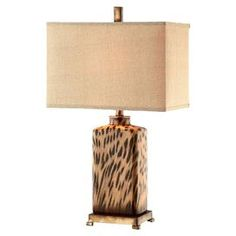 """Cheetah-inspired table lamp with a box shade.  Product: Table lampConstruction Material: Ceramic, metal and linenColor: Black and tanFeatures:  Cheetah motifAccommodates: (1) 100 Watt bulb - not included   Dimensions: 28.5"""" H x 16"""" W x 10"""" D"""