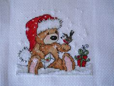 Rhona, who blogs over at Tangled Threads, has finished making her adorable Cookie Bear project, with added silver metallic threads for snowy sparkles! (Bonus chart available with issue 234 of The World of Cross Stitching mag)