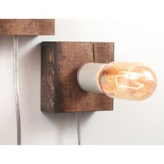 "Minimal and warmly rustic, a square of wood displays a glowing edison bulb. This listing includes 1 lamp. ITEM DETAILS ➤ Base measures 3.5""H, 3.5""W ➤ Base to bu..."