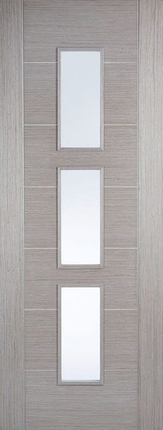 A ladder style design is created out of seven centre panels, all finished in a beautiful pre-finished Light Grey wood grain. This is further enhanced by three, slim panels centred to create a modern finish. Door Design, Brown Front Doors, Grey Doors, Sliding Screen Doors, Panel Doors Diy, Doors Interior, Grey Internal Doors, Internal Glass Doors, Old Wooden Doors