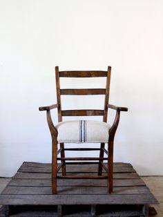 **LOVE the Seat**  Antique Lodge Chair with European Grain Sack Upholstery. #AmandaJaneJones