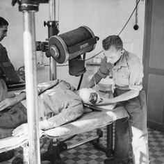 A soldier undergoing an X-ray prior to plastic surgery at No.4 Maxillo-Facial Surgical Unit, at 34th General Hospital in Algiers, 4 November 1943.