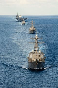 The Arleigh Burke-class guided-missile destroyer USS McCampbell (DDG 85) leads ships of the USS John C. Stennis and USS George Washington Strike Groups move in a formation in the Andaman Sea.