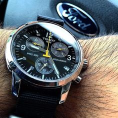 Ford and Tissot! A perfect #shutupanddrive photo by @mr.benzo07. Tissot is always a great Swiss option within our price range. The PRC 200 is a great grab-and-go chronograph that looks great on leather steel or NATO! #Tissot #Tissotwatch #Chronograph #natostrap #wristshot . . . . Find us at AffordableWristTime.com and use the tag #AffordableWT to be regrammed! #wus #womw #wruw #watchfam #watchgame #WatchGeek #hodinkee #wristcheck #watchnerd #wotd #watchcollecting #instawatch #Wristi #watches…