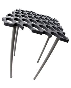 Surface Side Table A mass produced individually unique product.