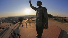 Statue+ Visitors view a statue of Nelson Mandela which overlooks the city of Bloemfontein, the birthplace of the ANC. Sunday Times Newspaper, Free State, Pretoria, Nelson Mandela, Statue, City, South Africa, Buildings, Sculpture