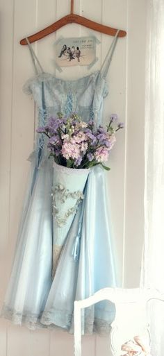 Baby Blue dress with  beautiful blooms. #styling. #flowers #dress