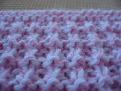 Hurdle Stitch    Work over an even number of stitches.  Rows 1 and 2: Knit  Rows 3 and 4: (K1, P1) across  Repeat rows 1 - 4.