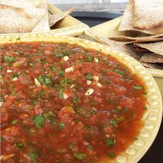 This Salsa packs a little heat & tons of garlicky-fav-restaurant-flavor. PERFECT for GameDay Ingredients for salsa: 2 Jalapeño peppers (seeds removed) 1 bunch fresh cilantro(stems mostly removed) 8-10 cloves fresh garlic 2-14 oz cans all natural... #bakingtortillachips #cleanappetizers #cleansalsa