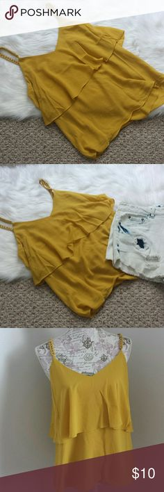 Burnt Yellow flow tank This is a burnt yellow flow tank. It had gold embellishments on the straps to add an extra fashion touch. It has never been worn so it is in new condition! It is 100% polyester. Tops Tank Tops