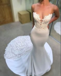 Available at www.theweddingdresscompany.co.uk Enzoani fitted crepe strapless mermaid wedding dress with lace detail and train