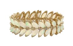 Opals April stone of month Stephen Webster Magniphe Feathers bracelet set in 18ct yellow gold opal and white diamonds