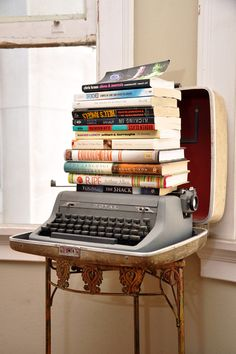 Put your collection of books on top of a typewriter to create o retro effect