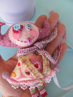 I am madly in love with this crazy little felt doll!