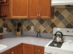 """DIY Backsplash. Stock up on a bunch of sponge brushes and fine brushes for the detail work. Get 1/4"""" painters or quilters tape or the grout. Pick paint colors and mix (if you want) to make the colors you will use. Paint squares randomly, remove tape, touch up as needed. Ta Da!"""