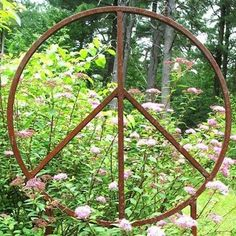Give peace a chance. I love this garden art!! <a class=