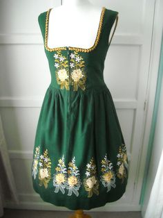 Such wonderfully lovely embroidery at work on this green vintage dirndl. #dirndl #dress #folk #costume #German #clothing #green #embroidery