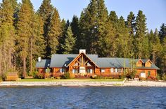 An eco-freindly log cabin in the woods and on the water with plenty of acreage for a small family farm.