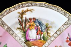 Antique Dresden Dinner Plate This is a beautiful antique floral Dresden dinner plate made in Germany by Richard Klemm. His designs were always fabulous. This is a great example of his great work. This is a beautiful floral, pink plate with colonial figures. You can use this plate as a dinner plate or use it as a fabulous cabinet plate. It would also be pretty hanging on a wall with a collection of plates.... This plate would make an outstanding addition to any collection. It is in nice…