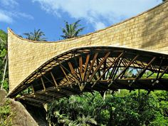 millenium bridge' by PT bamboo pure, bali, indonesia Bamboo Poles, Bamboo Art, Arch Bridge, Pedestrian Bridge, Green School Bali, Green Facade, Roofing Options, Bamboo Structure, Millennium Bridge