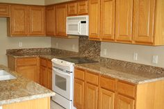 The granite really makes this kitchen beautiful.