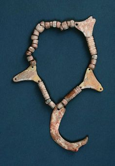 Amazing and unique prehistoric artifact - necklace with human rib. String is composed of beads and pendants made of animal bones and human rib. Moriš culture, around 2000 - 1500 BC, found in a grave of a woman no. 180 at prehistoric necropolis in Mokrin, Banat region, northern Serbia. So far, this is unique finding in European prehistory, because of using human bones as raw material. Collection of Museum in Kikinda.