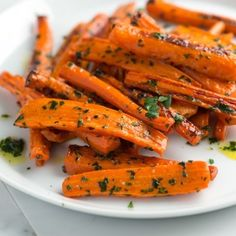 Simple roasted carrots recipe with a garlicky parsley butter. The carrots are sweet, tender and completely delicious.